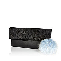 Black leather fold over pom pom clutch bag