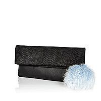 Black leather fold over pom pom clutch bag