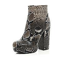 Beige snake print platform ankle boots