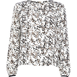 Cream spot print split back blouse