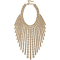 Gold tone statement strand necklace