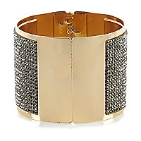 Gold tone diamante encrusted clamp cuff