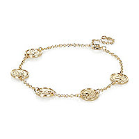 Gold tone coin bracelet