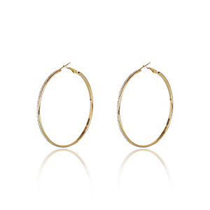 Gold tone white glitter hoop earrings
