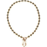 Gold tone pearl pendant ball necklace