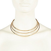 Gold tone triple torque necklace