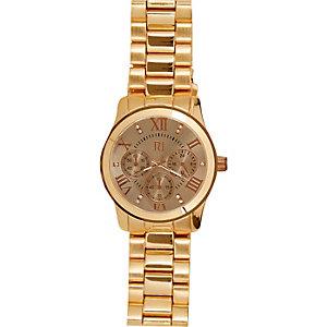 Gold tone oversized bracelet watch