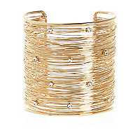 Gold tone multi wire encrusted cuff bracelet