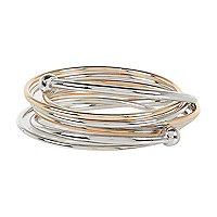 Silver tone and gold tone bangle cluster