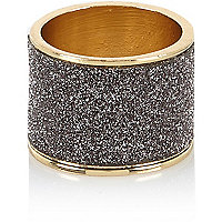 Gold tone grey glitter ring