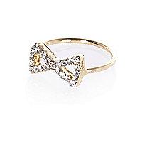 Gold tone diamante bow finger top ring
