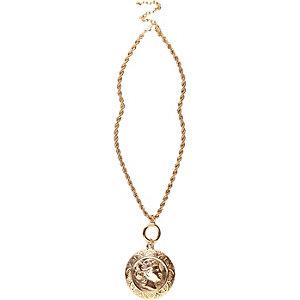 Gold tone coin pendant necklace