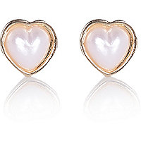 Gold tone heart pearl stud earrings