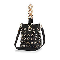 Black eyelet chain handle duffle bag