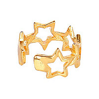 Gold tone repeat star ear cuff
