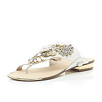 White slip on embellished sandals