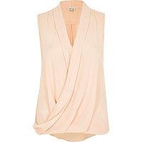 Beige sleeveless wrap blouse