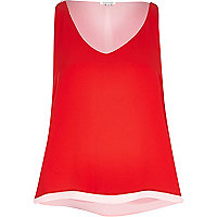 Red flowing contrast hem top