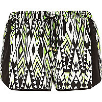 Green Aztec print running shorts