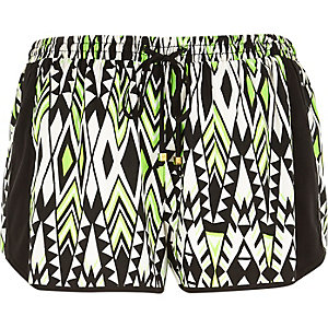 Green geometric print running shorts