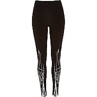Black glowing spiderweb print leggings