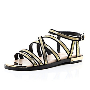 Black and gold strappy gladiator sandals
