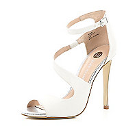 White textured asymmetric wrap front sandals