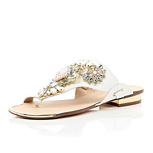 White heavily embellished sandals