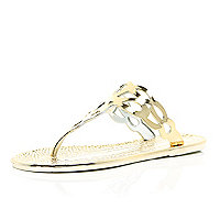 Gold metallic jelly sandals