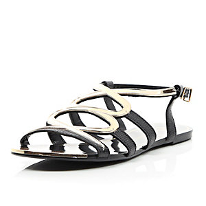 Black gold trim gladiator sandals