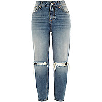 Mid wash ripped knee ultimate boyfriend jeans