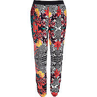 Red tropical print joggers