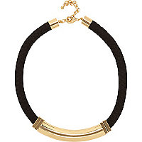 Gold tone bar black rope necklace