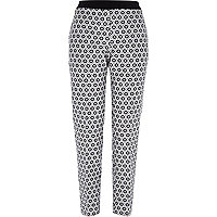 Black hexagonal print cigarette pants