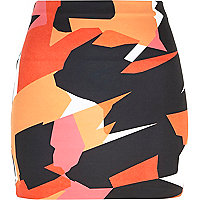 Orange graphic print mini tube skirt