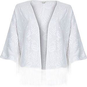 White embroidered boxy cape