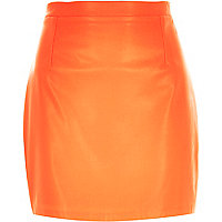 Orange leather-look mini skirt