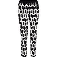 Black geometric print cigarette pants