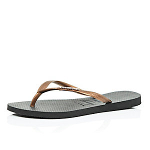 Black and brown Havaianas flip flops