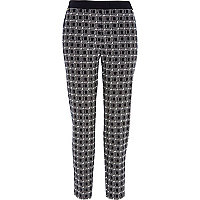 Black check jacquard trousers