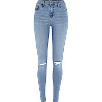 Pretty light blue ripped knee Molly jeggings