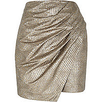 Gold metallic wrapped drape mini skirt