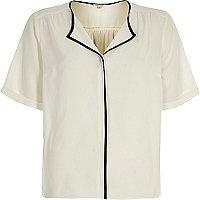 White short sleeve black trim blouse