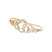 Gold tone diamante filigree palm cuff