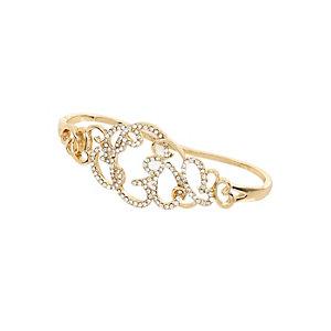 Gold tone diamante filigree palm cuff