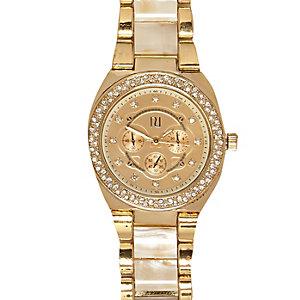 Gold tone cream face diamante watch