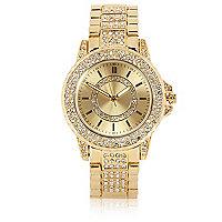Gold tone gem encrusted watch