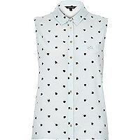 Blue heart print sleeveless shirt