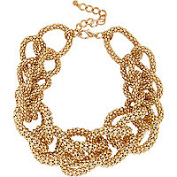 Gold tone chunky knotted statement necklace