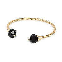 Gold tone twist black stone bangle